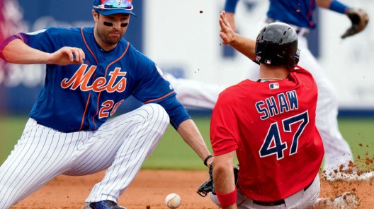 Mar 20, 2016; Port St. Lucie, FL, USA; New York Mets second baseman Neil Walker (20) is late on tagging out Boston Red Sox first baseman Travis Shaw (47) at second base during a spring training game at Tradition Field. Mandatory Credit: Steve Mitchell-USA TODAY Sports